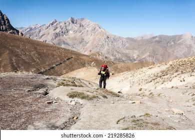 Hiker in Fann mountains, central asia, Tajikistan.