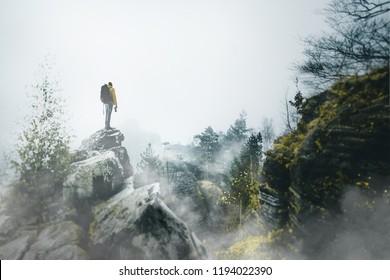 Hiker in a fog landscape