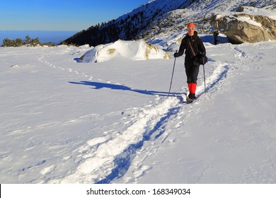 Hiker follows the trail on snowy mountain