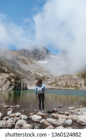 Hiker in front of Lake in French Alps, Chamonix (Mont Blanc)