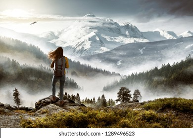 Hiker in front of picturesque landscape