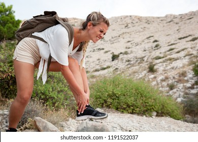 Hiker girl with ankle injury feels pain in leg