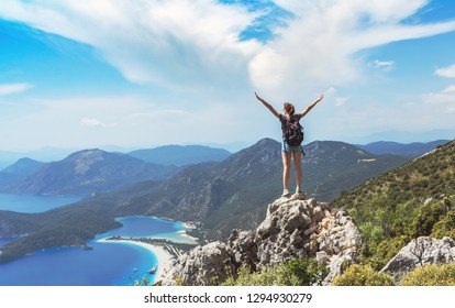 Hiker girl on the mountain top, сoncept of freedom, victory, active lifestyle, Oludeniz, Turkey