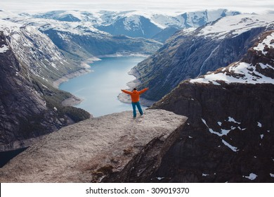 Hiker hiking with backpack looking at mountains Nature,beautiful nature landscape. Portrait of male adult back standing outdoor.Hike during trek to Trolltunga,Norway.Active healthy,strong