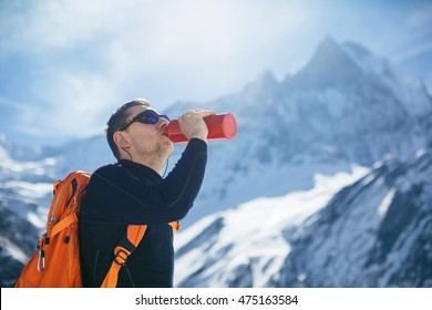 Hiker hydration. Hiker drinking water from water bottle