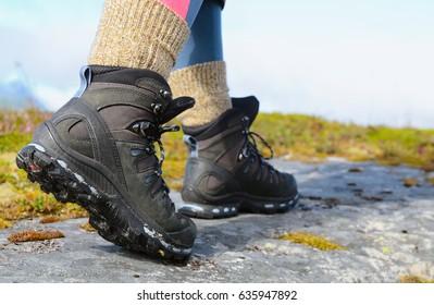 hiker legs in trekking boots