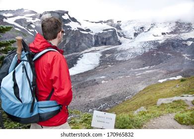 Hiker looking at Glacier Vista in Mt. Rainier National Park,Washington State, USA