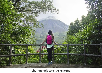 Hiker looking out at the Arenal volcano in Costa Rica