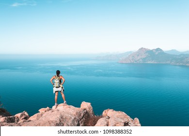 Hiker looking at the view at Calanques de Piana in Corsica, France