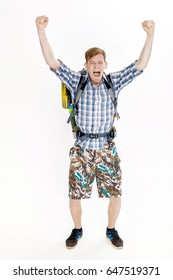 Hiker man with backpack rising arms in victory sign on white background