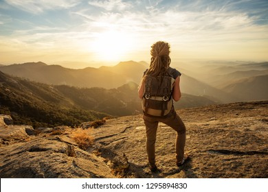Hiker meets the sunset on the Moro rock in Sequoia national park, California, USA.