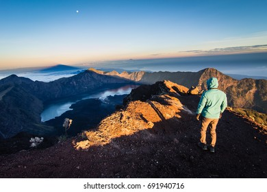 A hiker at  Mount Rinjani summit. Mount Rinjani is an active volcano in Lombok, Indonesia.