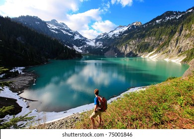 Hiker on the Blanca Lake, Washington. State. Located in the Henry M. Jackson Wilderness Area, Beautiful turquoise green lake. Only accessible by foot. Elevation Gain: 2700 ft in. 5 hours, 8 miles.