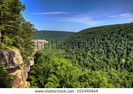 Hiker on the famous Hawksbill Crag in Arkansas.