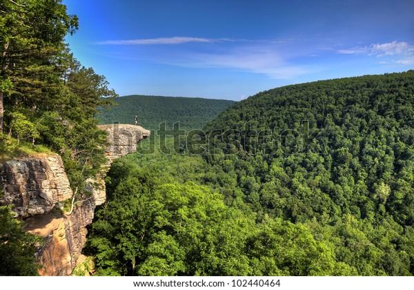 Hiker on the famous Hawksbill Crag in Arkansas.