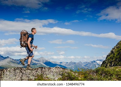 Hiker on the mountain ridge. Sport and active life concept