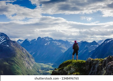 Hiker on the mountain top. Sport and active life concept