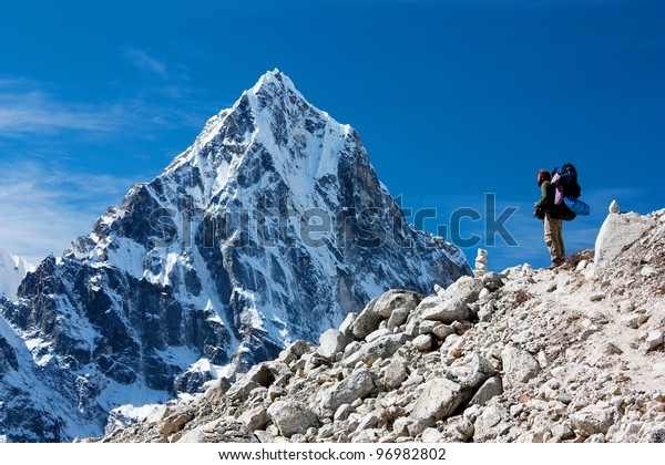 hiker on mountains - hiking in Nepal - way to everest base camp