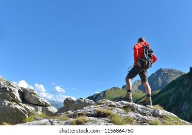 hiker on peak mountain