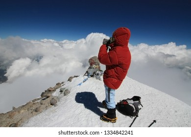 Hiker on the peak of mountain