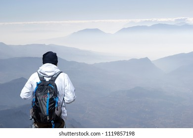 Hiker on the summit of a mountain in matese park