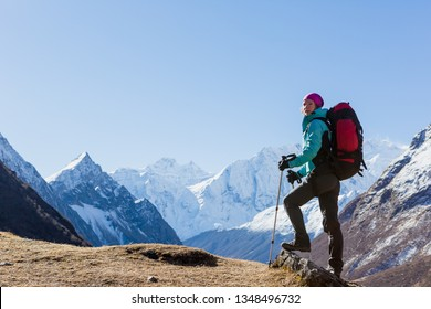 Hiker on the top in Himalayas mountains. Travel sport lifestyle concept