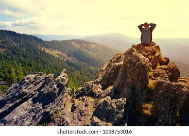 Hiker on the top of the mountain Klein Osser in National park Bayerische Wald, Germany.