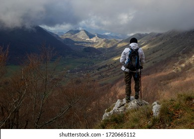 hiker on the top of a mountain letino valley