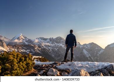 Hiker on the top of Mt. Vrh Korena in Kamnik Savinja Alps (Slovenia)