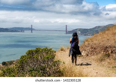 Hiker on trail to Mt. Livermore on Angel Island in San Francisco, Ca on a sunny day
