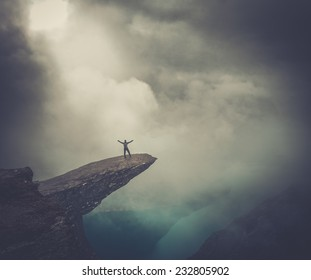 Hiker on Trolltunga with arms wide open
