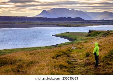 A hiker on Vatnsnes Peninsula in Northwestern Iceland