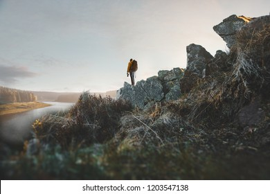Hiker photographs landscape