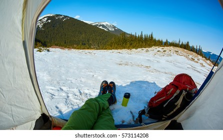 hiker resting in the tent in the Carpathians mountains at winter