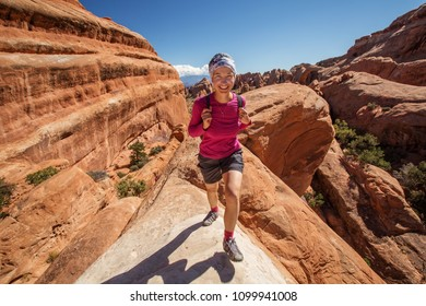 Hiker rests in Arches National park in Utah, USA