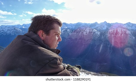 Hiker rests on Mt. Rundle