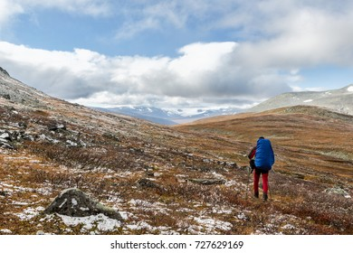 Hiker in the Sarek national park in Lapland Sweden at autumn