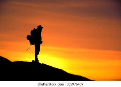 Hiker silhouette during sunset on the Hajla mountain  in Montenegro