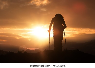 Hiker silhouette sunshine