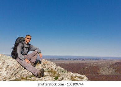 hiker sit on a mount top