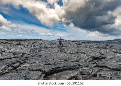 Hiker standing on Active Lava field at Hawaiian Vocalnoes National Park Hawaii