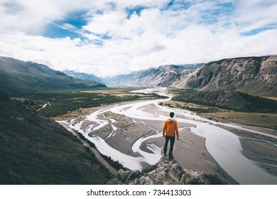 Hiker standing on summit in Patagonia mountains