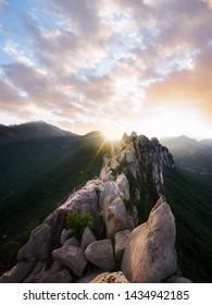 Hiker standing on top of Ulsan mountain during sunset - Korea Seoraksan National Park