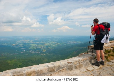 Hiker stands on a peak and enjoy the scenery