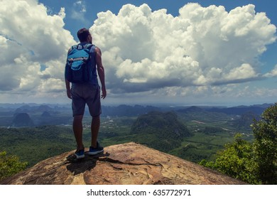 Hiker stay on a cliff