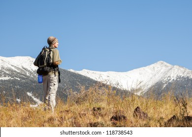 Hiker Stops to Look at Mountain View (Humphrey's Peak in Flagstaff, Arizona)