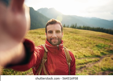 Hiker taking a selfie while out trekking in the wilderness