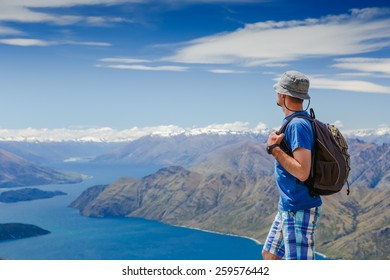 hiker at the top enjoy sunny day. New Zealand