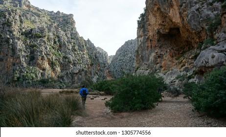 hiker in Torrent de Pareis Serra de Tramuntana Mallorca Spain off-season January