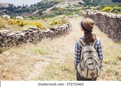 Hiker traveler woman on a hiking trail, travel and active lifestyle concept